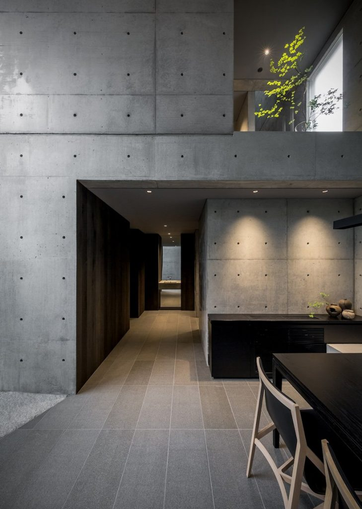 Gosize builds concrete residence on top of a natural stone base in japan